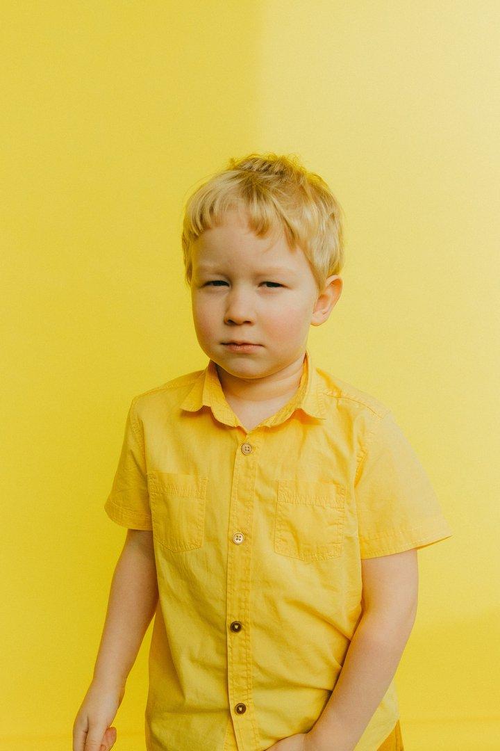 Suspicious Boy in Yellow